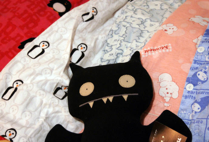 Ugly Doll bat plush toy. Cute kawaii pajamas from Hong Kong and Japan. Cute kid's nightgown, PJs with penguins.