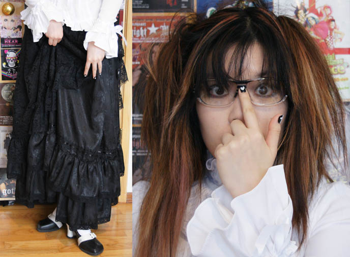 Nerdy hipster glasses, heavy dark frames on young girl. Long Victorian or Edwardian skirt, Elegant Goth Lolita Aristocrat EGL style from Tokyo Japan.