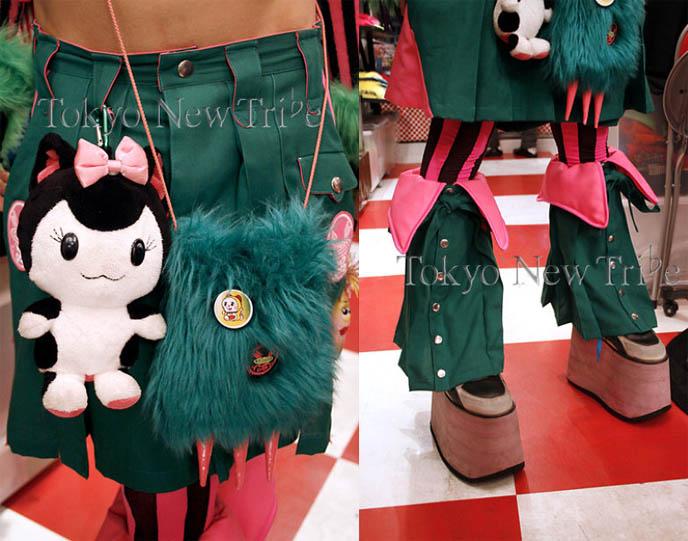 Tokyo shopping. DJ Sisen from Japan of Tokyo Decadance nightlife and nightclub. Wild cyber rave fashion, Takuya Angel Japanese designer brand  clothing from Harajuku store. Crazy biohazard goggles, faux fur seeing eye backpack.