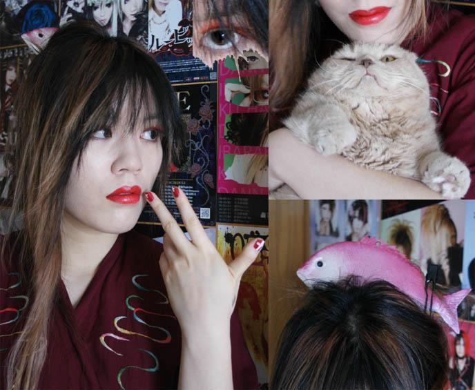 Japanese nail art and fake eyelashes. Geisha Japanese girl makeup, red eyelashes and bright red lipstick on cute Asian girl. Fake plastic fish on head