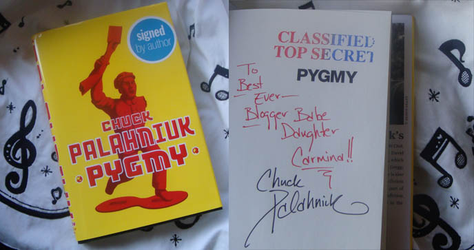 Chuck Palahniuk autographed book, author signature. Pygmy book signing speech and reading, fight club cult writer books.