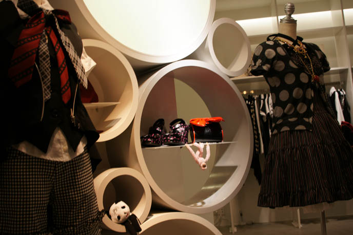 Cool circular shelves, designer modern furniture, 1960s bubble shelf in boutique. Black Peace Now store in Marui One Shinjuku, Gothic Lolita designer fashion, puff petticoats, bell shaped skirts, polka dot tops. Where to buy Japanese women's clothing, cute stores in Tokyo Japan, shopping map.