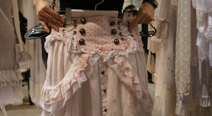 Pink and white skirt with buttons, high waist. Gramm collection, Gothic Lolita dresses, deconstructed faded asymmetrical lace pastel clothing, designer garments from Japan, Rococo skirts, avantgarde clothes from Tokyo, MaruiOne shopping complex or department store.