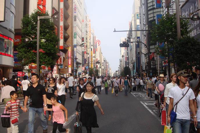 MaruiOne Shinjuku, marui young summer sale, Shinjuku busy street, closed off traffic, Tokyo people walking, billboards bright neon signs in Tokyo Japan