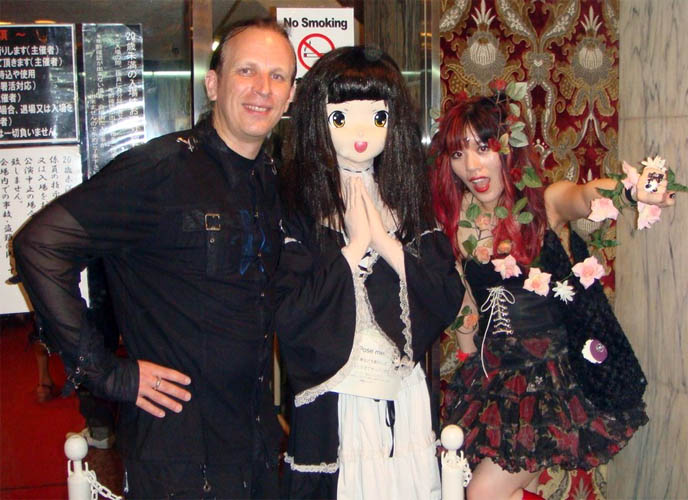 fetish parties in Japan, Department H, weird crazy parties in Tokyo, Japanese strange fetishes, events and club nights, Goth drag queens, S&M, flogging and domination, bondage shows, male submissive in corset, theatrical leopard makeup