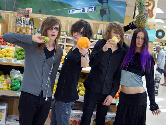 boy holding citrus fruits, type of citruses, lemon lime orange, best trader joes grocery products, laurel canyon sunset boulevard trader joes, organic natural groceries in los angeles, la trader joe best products, cheap wines, two buck chuck, cute emo boys, emo band