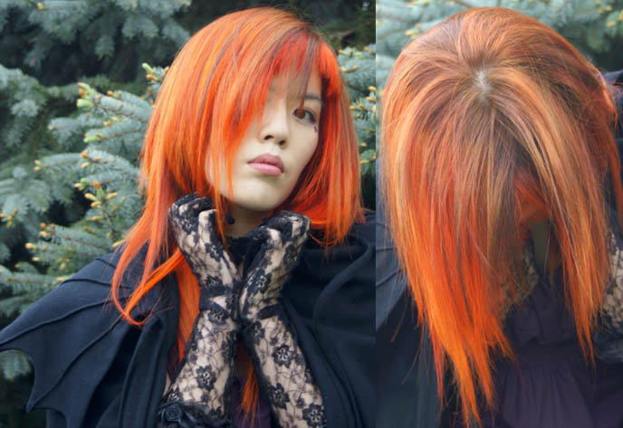 bright neon orange hair, emo girl hairstyle, la carmina, NEW ORANGE HAIR, SPECIAL EFFECTS BRIGHT ORANGE COLORFUL DYE, JAPANESE MODERN HAIRCUTS, pumpkin head hair, extreme hairstyles, avantgarde Tokyo, LACE GLOVES, black peace now VAMPIRE CAPE, gloomth dress