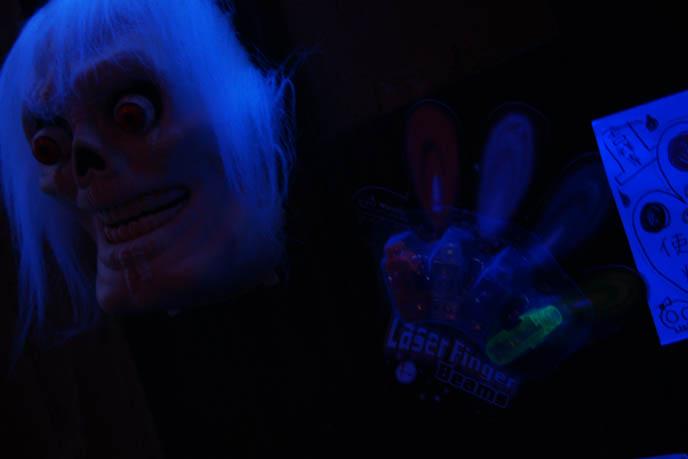 skull mask, scary glow in the dark disguise, BLUE TOKYO: COOL NIGHTLIFE PHOTOGRAPHY. JAPAN AFTER DARK, GLOWING NEON LIGHTS, WALRUS & HIS BUCKET. jpop cosplay Japan, world's weirdest strangest restaurants