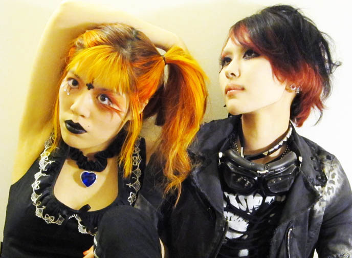 japanese goth girls, orange hair in pigtails, TOKYO EVIL QUEEN VIDEO! SUGARPILL MAKEUP TUTORIAL, FEATHERED EYELASHES, GOTH BLACK LIPSTICK & MINIONS. JAPANESE tv, BLACK GOTH LIPSTICK, EXTREME FAKE EYELASHES, FEATHERED EYELASHES, glittery mineral eye makeup, heart of the ocean Titanic necklace, funny comedy beauty demo, innocent world gothic lolita dress