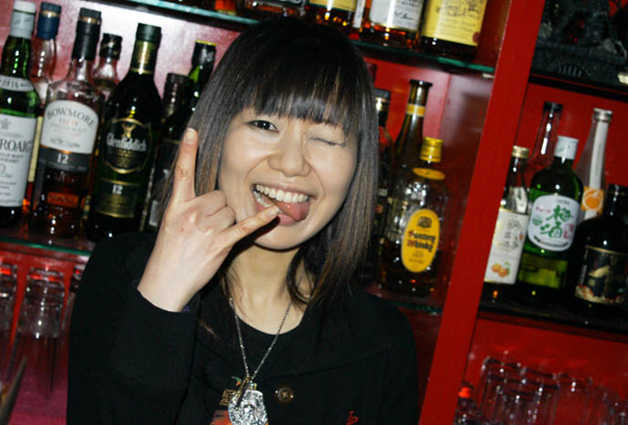 cute japanese goth girl, heavy metal hand signal, goth bars in japan, umeda bars osaka, BAR MIDIAN IN OSAKA, OWNED BY FUKI vocals VISUAL KEI BAND BLOOD. HARD ROCK HEAVY METAL gothic BARS IN JAPAN, JROCK VK HANGOUTS. キッチュ. japanese dive bars, rock concerts performances