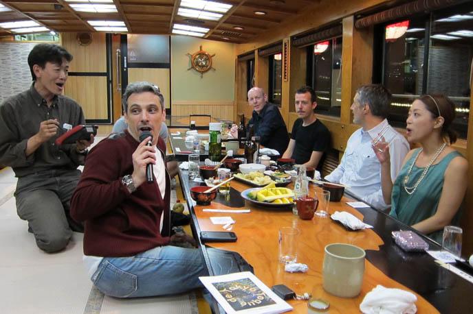 japanese singing karaoke, silly funny photos karaoke songs, dancing performance, ANTOINE DE CAUNES, FRENCH TV HOST OF EUROTRASH & CANAL PLUS TOKYO DOCUMENTARY. ODAIBA DINNER BOAT CRUISE & KARAOKE, TOKYO BAY activities, boat tour, antoine de caunes paris television presenter, actor, writer and film director
