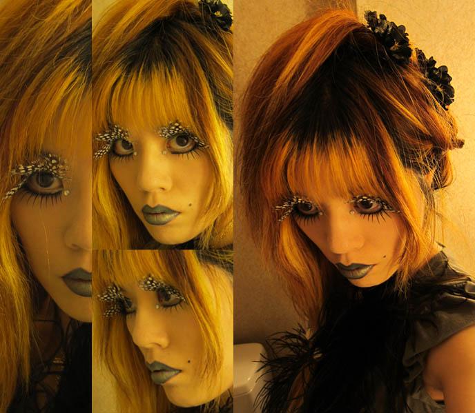GOTH FEATHER EYELASHES, STEAMPUNK LIP SERVICE SKIRT, GREEN LIPSTICK, FEATHERED BOA. D'ESPAIRSRAY VISUAL KEI CONCERT OUTFIT. dramatic false eyelashes gothic cyber, how to put on fake lashes, japanese goth fashion, harajuku style, inspiration makeup photos