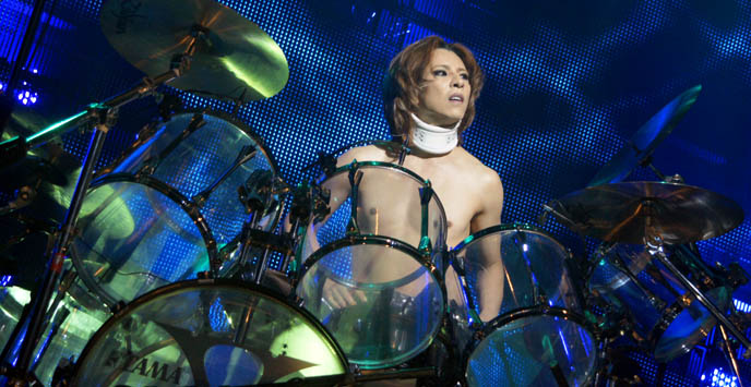 yoshiki playing drums, drummer leader of x japan, japanese most famous rock bands in japan, photos canada concert, movie dvd tour video, yoshiki at drum kit standing, hot jrockers, cute jrock boys, X JAPAN LIVE PERFORMANCE PHOTOS,  CONCERT REVIEW photos of yoshiki, NORTH AMERICAN TOUR 2010, VANCOUVER. drummer pianist japanese rock stars YOSHIKI, TOSHI, SUGIZO. heath, pata, x japan concerts stage outfits, jrock concert, エックス ジャパン, visual kei artists bands music, buy j-rock tours concerts, xjapan tickets