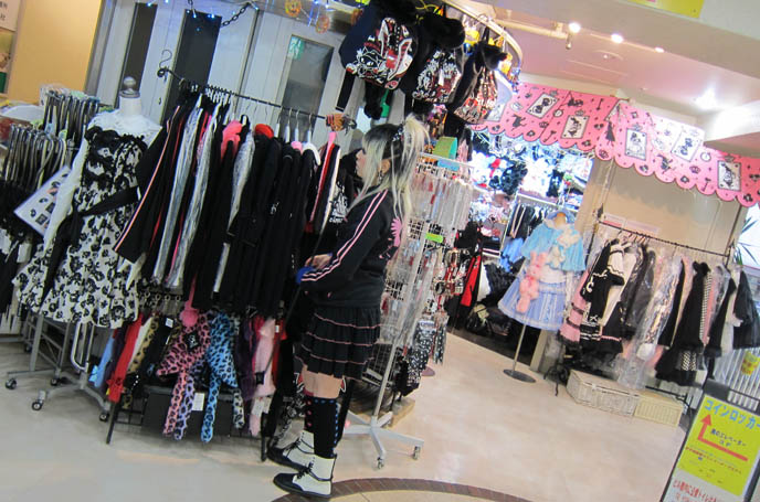 2 Cute Clothing Store Girls Nearby the Maxicimam store