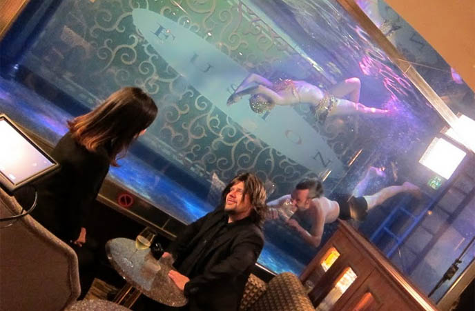 mermaid swimming in fish tank, cosplay, mermaid restaurant bar, live mermaids swim, roppongi the mermaid, japanese hostesses, ari behn tattoo, shirtless, swim, snake tattoo on arm, host boys club, tokyo japan hostess, husband of Princess Märtha Louise of Norway, ARI OG PER, tv show hosts male, PRINCE OF NORWAY. travel host tv, Ari og Per NRK, Per Heimly. Prince of Norway, NRK Programmer, famous Norwegians, travel tv show, european tv hosts, japanese pop culture, weird japan