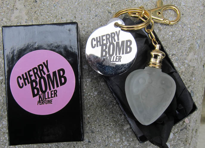 CHERRY BOMB KILLER PERFUME GIVEAWAY! ROCK N ROLL GOTH PUNK PERFUMES & HEART CHARMS. ATELIER PIERROT DRESS. my fair lady hta, sunhat wide brim, cute hats, striped black and white dress, lolita fashion, young lolitas, lolita models, asian female model, emilie autumn makeup, red doll hair, smoky eyeshadow, how to do smokey eyes, RED HAIR dye, alternative emo hairstyles